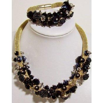 Ketting&armband goud-zwart met roosjes