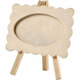 Objekten zum Dekorieren / objects for decorating Houten frame met golvende rand, gemonteerd op een ezel