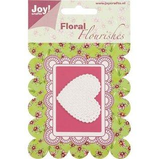 Joy Crafts, découpant et gaufrant le coeur de pochoir.