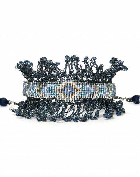 Nilu gray crochet bracelet with tassel