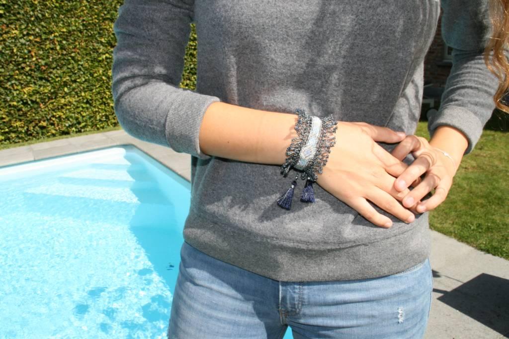 Nilu Nilu gray crochet bracelet with tassel