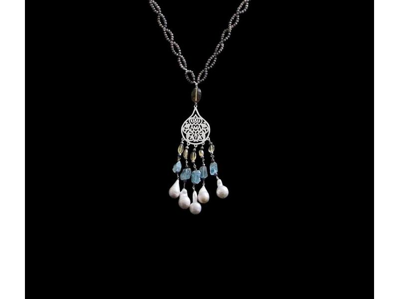 LONG PEARL NECKLACE, LARGE ARABESQUE AND TASSELS