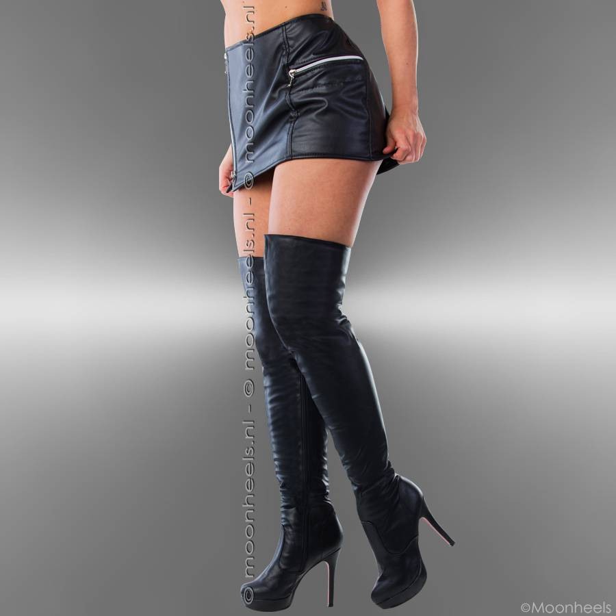 Black over knee boots with red soles and platform