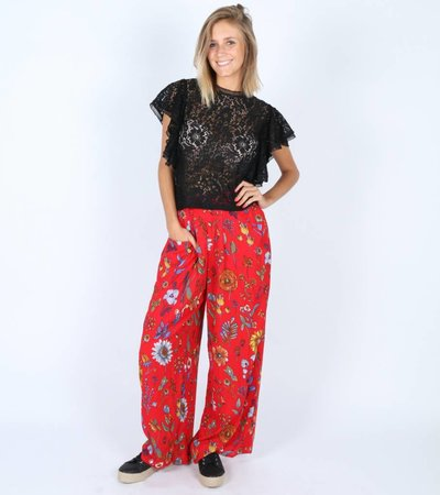 RED MADNESS FLARED TROUSERS