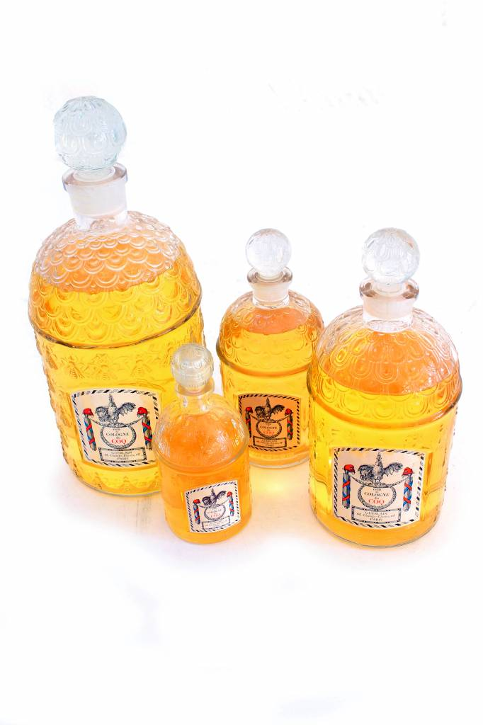 Decorative set of Guerlain perfume bottles.