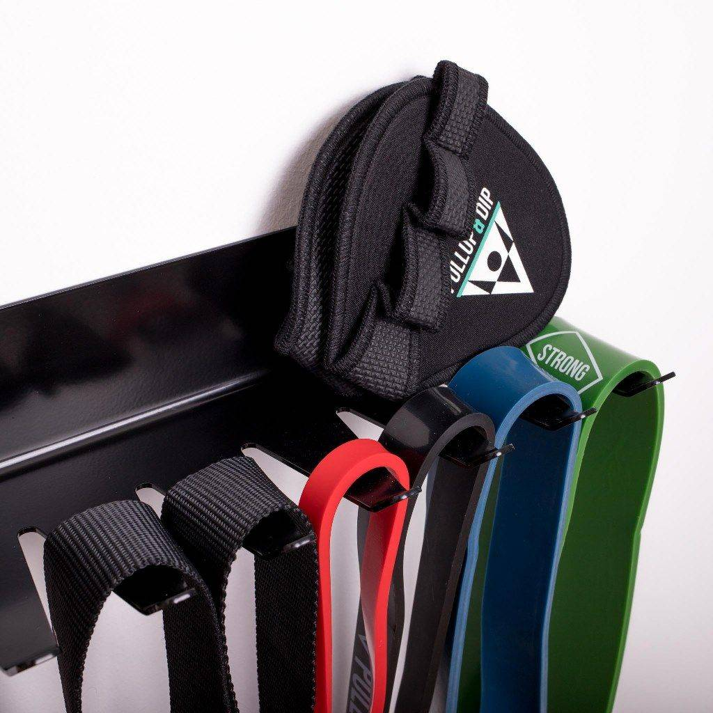 Wall mounted gym storage rack for equipment like resistance bands, jumping ropes, gym rings or sling trainer