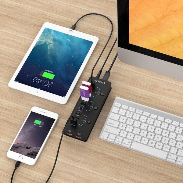 Orico hub USB avec neuf ports de type A 2x USB Ports 1A et Charging 2.4A - 3x interrupteur marche / arrêt - Voyants - Incl. Adaptateur - Noir