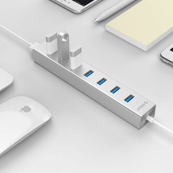 Orico Aluminum USB3.0 Hub with seven Type-A ports - 5Gbps - VIA chip - works with Windows, Linux and Mac OS - Mac Style - incl. 10W Power Adapter / 1M Data Cable - Silver