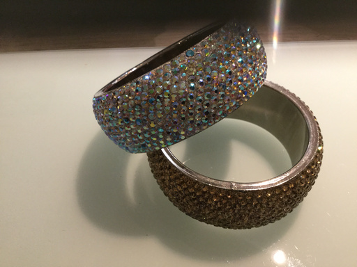 Gemini 2 thick crystal embelished bangles, one gold and one silver