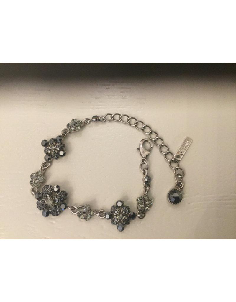 black bracelet with flower stones