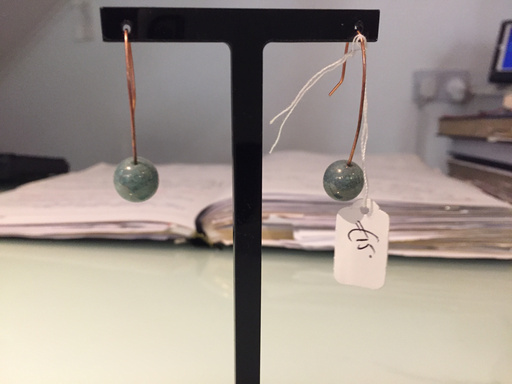 Gold drop earring with green pearl