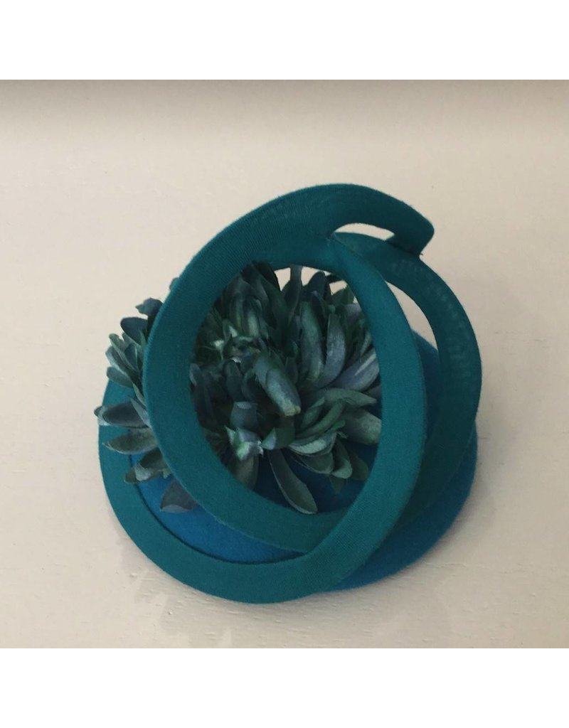 Fiona Mangan Fiona Mangan Teal Green felt hat with swirl and flower detail.