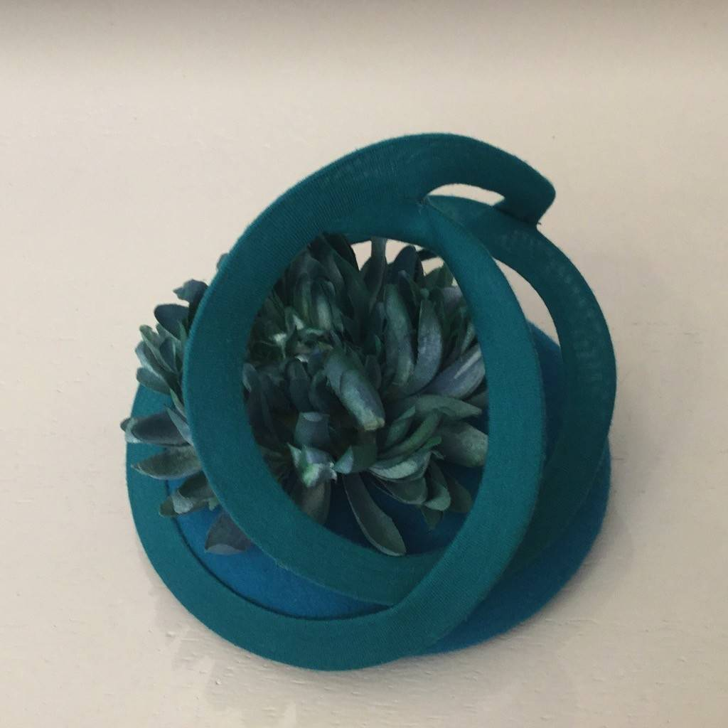 Fiona Mangan Fiona Mangan Teal Green felt hat with swirl and flower detail.