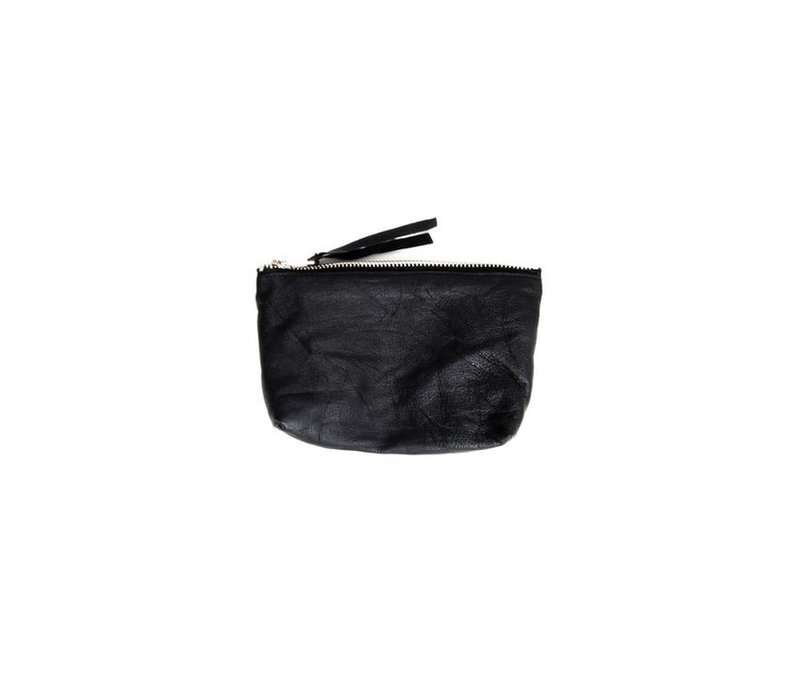 Qai Toiletry Bag, made from recycled leather goods.