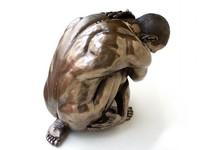 Parastone 'Man Squatting' bronze, XL