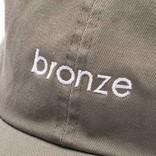 Bronze Script Cap Olive
