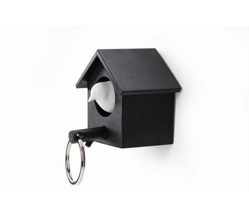 Cuckoo Key black house/white bird