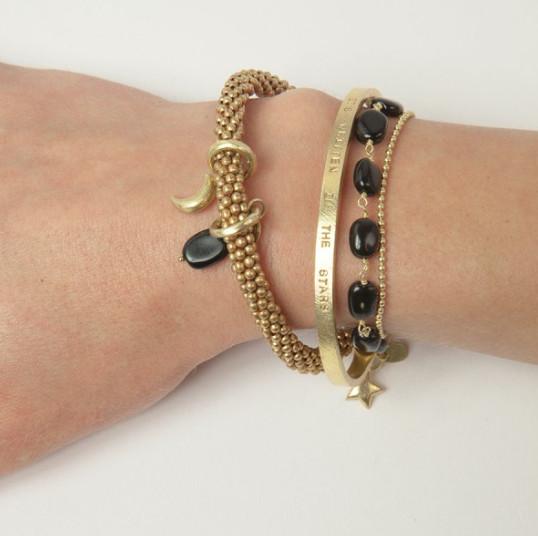 a Beautiful Story Glow zwarte onyx - Armband goud
