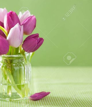 Vintage Purple tulip flowers bouquet in vase