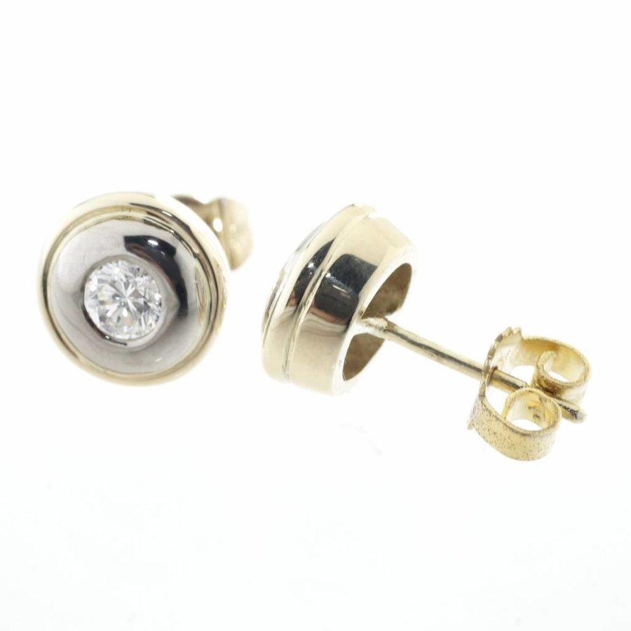 1 paar 18 krt. wit gouden oorknoppen met briljant