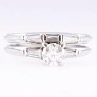 14 krt witgouden ring met briljant van ca. 0.40ct en baquette geslepen Diamanten van ca. 0.25ct