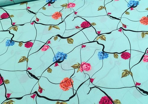 De Stoffenkamer Viscose crepe flowers turquoise