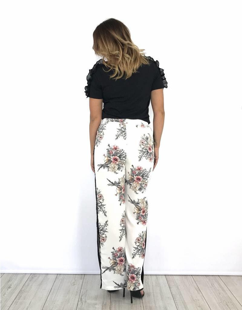 White pants flowers drukkers