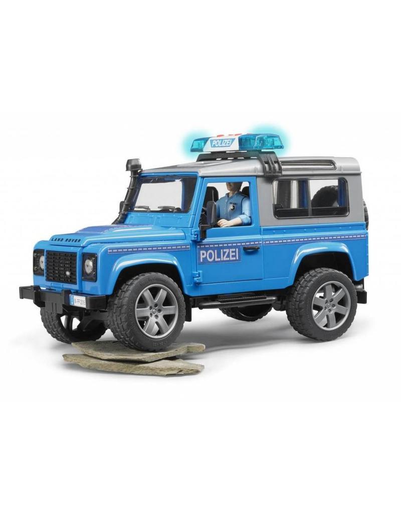Bruder Bruder 2597 - Land Rover Defender Stationwagen - Politieauto en politie agent