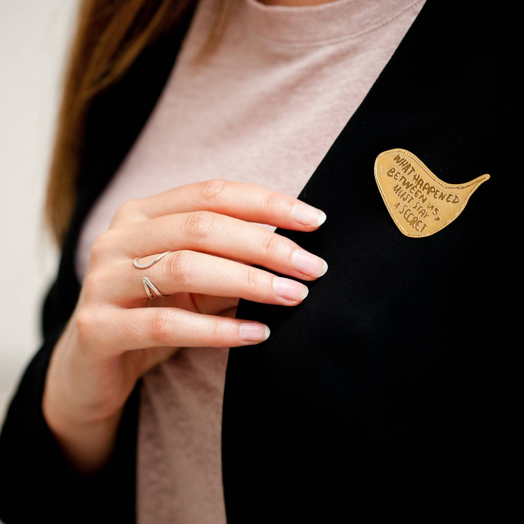 gold plated brooche 'What happened'