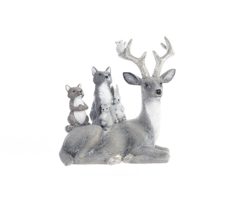 Sitting silver deer with animals on its back