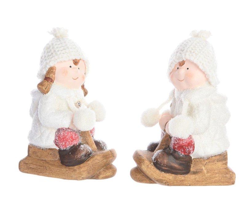 Winter boy or girl on sleigh