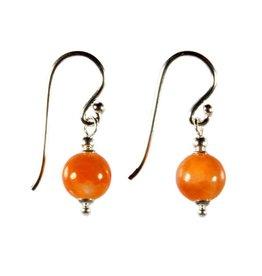 Zilveren oorbellen calciet (oranje) rond 8 mm