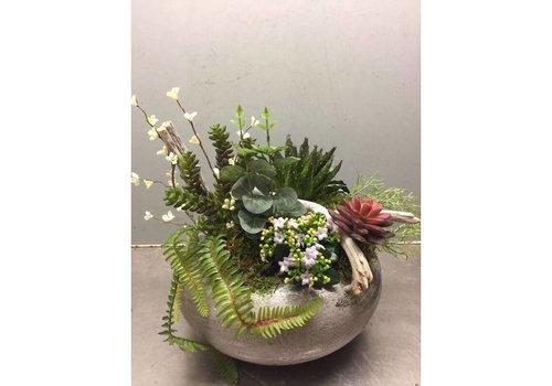 Zijden plantenarrangement rond