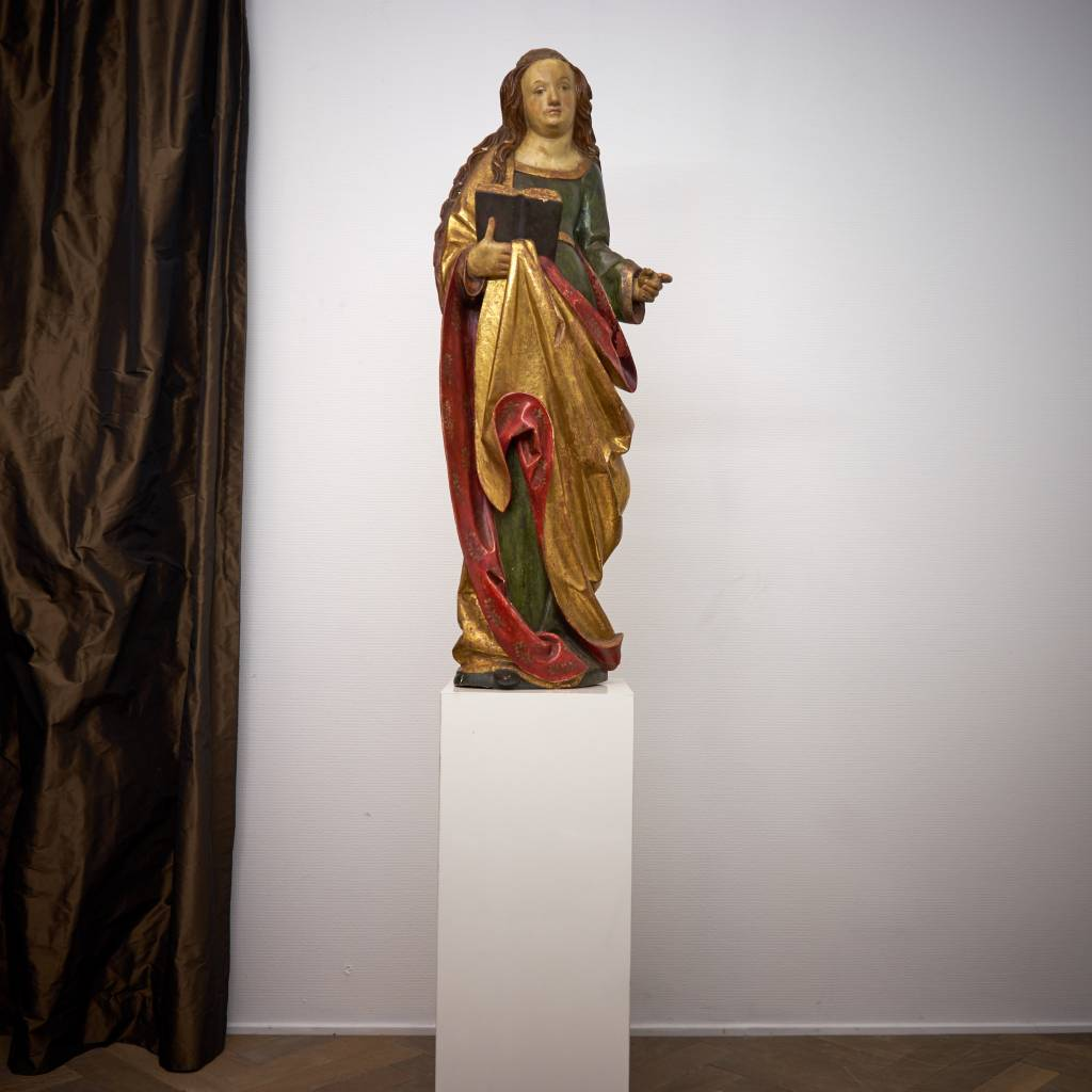vrouwelijke heilige met boek