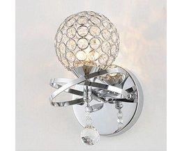 Vägglampa med krom och kristall
