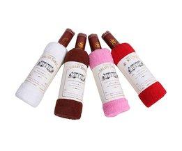 Handduk som en present i vinflaska