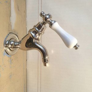 Wall faucet with porcelain handle
