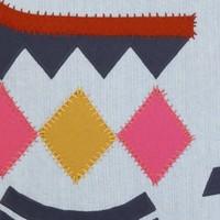 Tucan denim patchwork cushion