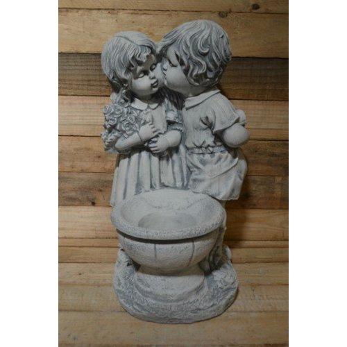 Jongen en meisje met een plantenbakje ( H 59 cm)